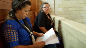 Sophra Figgens of Red Cloud and Gina Hofaker of Holdrege watch legislative debate from the balcony.